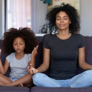 mother and daughter meditating - mindful parenting