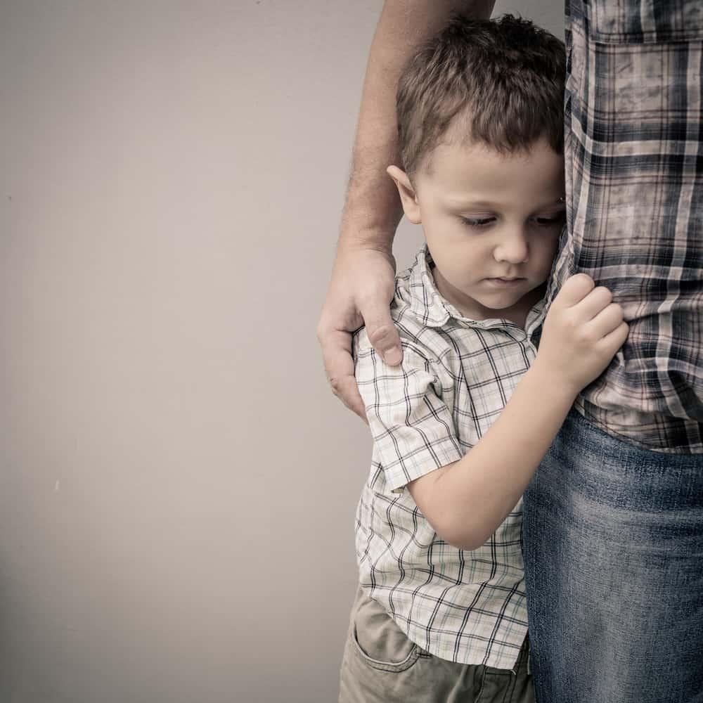 school transitions - boy hugging dad - mental health awareness month
